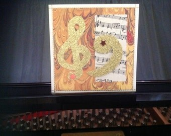 Music greeting card GoldClefs
