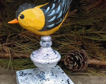 Hand Carved Gold Finch Bird carved from White Pine.  Perched on antiqued finial.