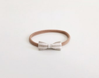 tiny taupe striped bow
