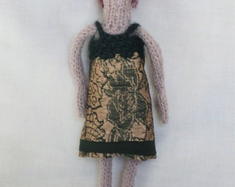 Hand Knitted Doll Wearing a Pretty Green Dress