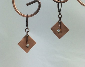 Antiqued copper and Swarovski crystal dangle earrings with leverback ear wires.