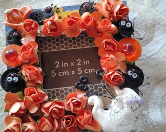 HALLOWEEN FRAME. paper roses, bugs, ghost, vintage jewelry, buttons, handmade