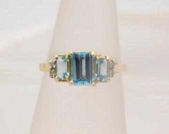 1.75 Carat T.G.W. Ladies Emerald Cut Blue Topaz & Diamond Ring 14K