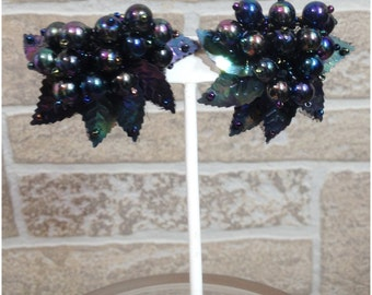 Fabric backed black iridescent beaded pierced earrings with plastic leaves