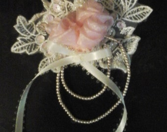 Beaded applique rose corsage