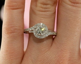 6.0mm Forever Brilliant Moissanite and Diamond Halo Engagement Ring in White Gold (also avail. in rose, yellow gold and platinum)