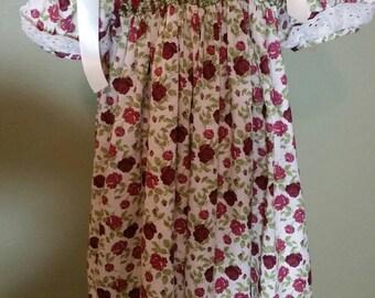 Smocked flowers print dress size 2