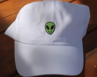 Alien patch on white baseball hat