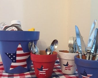 America!!!  Hand painted red, white and blue terra cotta pots with Stars and Stripes vinyl decals.