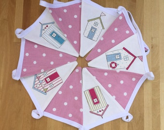 Pink Beach Hut Bunting. Featuring 5 pink and white polka dot flags with 5 beach hut flags for a sea side themed bunting