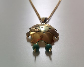 Brass round pendant with little turquoise beads