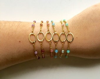 Beaded bracelet. Bracelet with gold circle. Bracelet with colored beads.