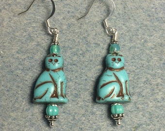 Turquoise Czech glass cat bead dangle earrings adorned with turquoise Czech glass beads.