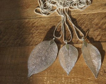 Necklace with beautiful silver pendant of a leaf