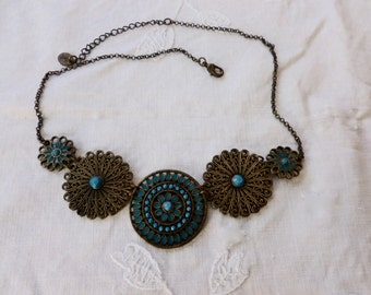 Claire's turquoise and brass necklace