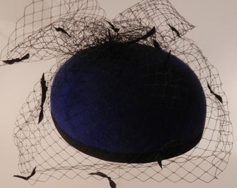 Bright royal blue wool felt pill box hat with black satin ribbon bow bird cage veiling.