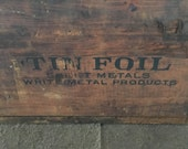 Fantastic 1920s TIN FOIL wooden crate. Stamped on two sides. Deep long & narrow box perfect for storage, plants, beverages, anything.