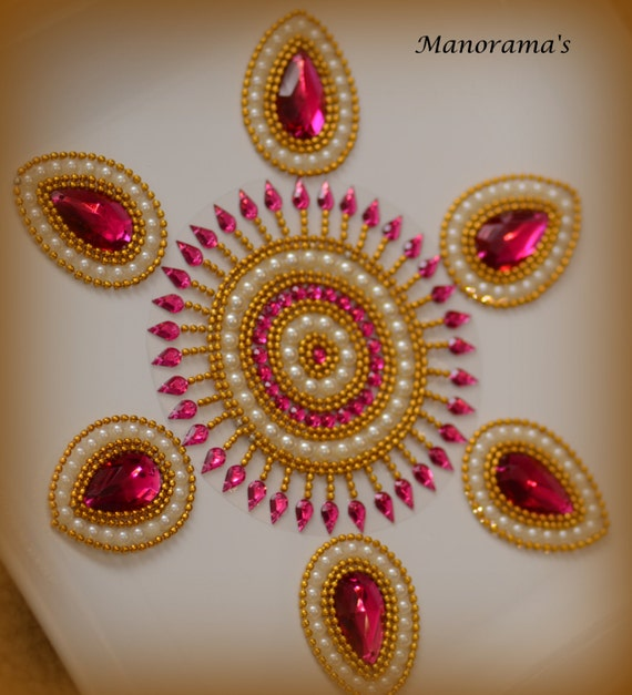 Floor art kundan rangoli designs studded with large tear for Floor rangoli design