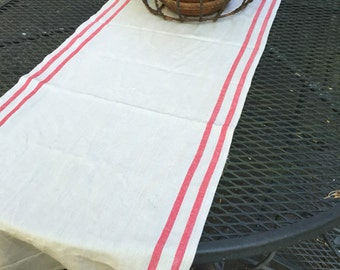 Tan table runner with red grain sack stripes