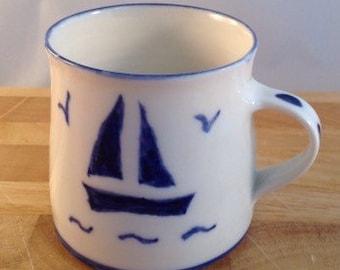 Handmade Porcelain Mug with royal blue sailboat design