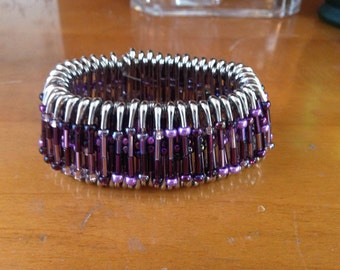 Safety pin bracelet in purples