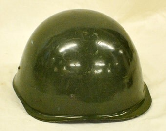 WWII Helmet with leather liner and chin strap. Not researched