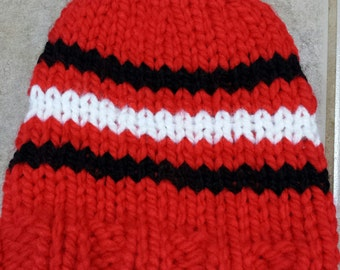 Hand knitted red striped kids hat.