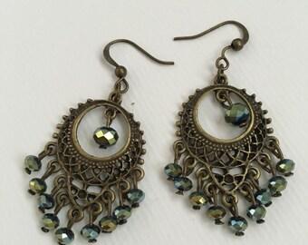Crystal drop earrings, bronze tone, green crystals.