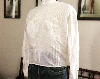Beautiful ivory silk victorian blouse.