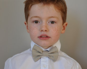 Boys bowtie in black, beige and white check with rich red neck strap by Fred's Finery's 'Edward'