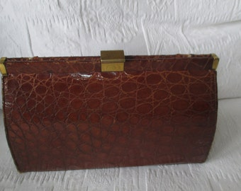 Classy vintage crocodile clutch bag with brass fitments and a gorgeous suede interior
