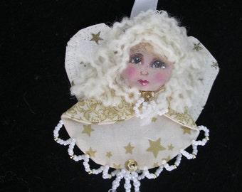 An Angel Brooch/Cloth doll angel brooch