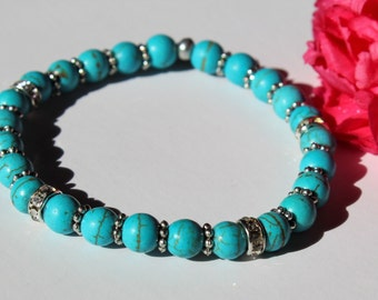 Turquoise bead stretchy bracelet with silver colored spacers and some CZ ronzelles