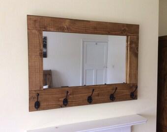 Rustic solid reclaimed wooden mirror with coat hooks in oak wax