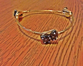 Bow wire bangle
