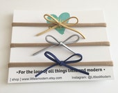 Pack of 3 dainty faux suede bow headbands- include navy, silver, mustard