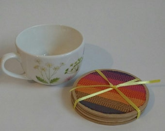 Wrap fabric coasters, set of 4 tea coasters with lenny lamb sunset rainbow wrap fabric on wooden base.