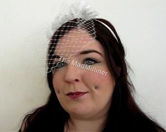 Floral veiled bridal hairband