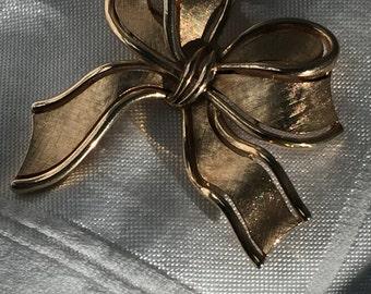 Crown Trifari gold tone bow brooch