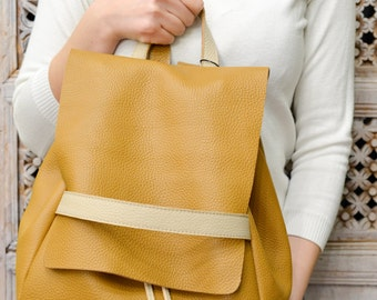 Natural soft leather backpack . Custom colours also available on request