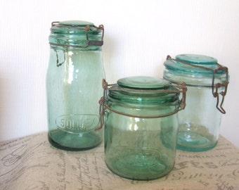 A group of 3 green kilner jars
