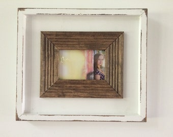 Lightly distressed, shadow box 5x7 picture frame in white.