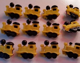 Lot # 4 plastic yellow locomotive buttons