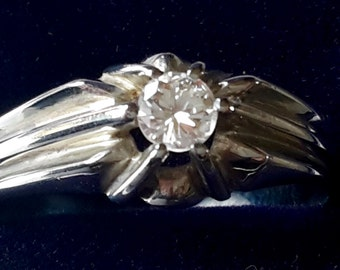 A stunning quality art deco 18ct white gold 0.30 ct diamond solitaire gypsy ring