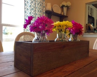 Stained wood trough centerpiece with large mason jars