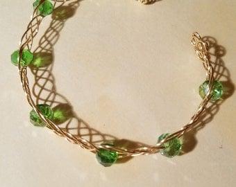 Beautiful gold tone celtic braid green beaded wire bracelet