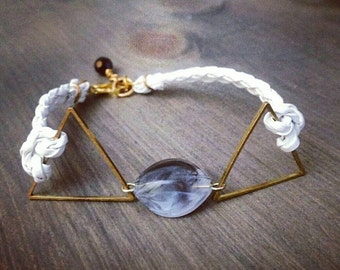 Bracelet with stone and white cord