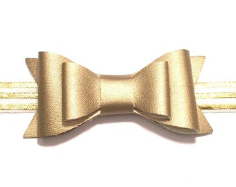 Large Oversized Gold Leatherette Bow On A Gold and White Striped Headband