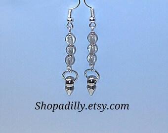 Shiny dangle earrings.