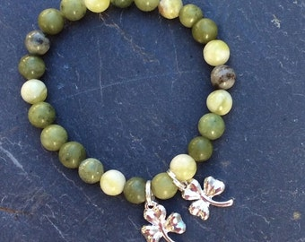 Connemara marble bracelet with lucky shamrock charms.